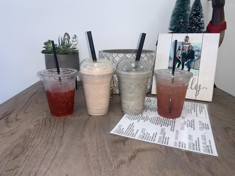 Shores Nutrition, pomegranate green tea, strawberry banana peanut butter, oreo pepermint milkshake and Skittles tea, all healthy drinks.