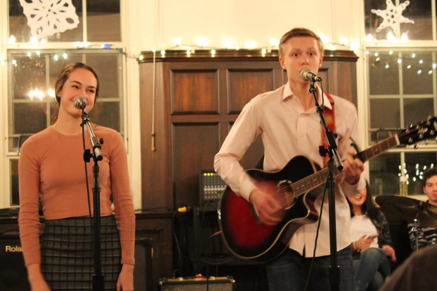 Josie+Monahan+%2720+and+Billy+Vogel+%2721+perform+during+last+year%27s+Coffeehouse.+The+event+has+previously+been+held+during+the+holidays+but+was+moved+to+March+this+year.+Photo+by+Victoria+Gardey+%2720.