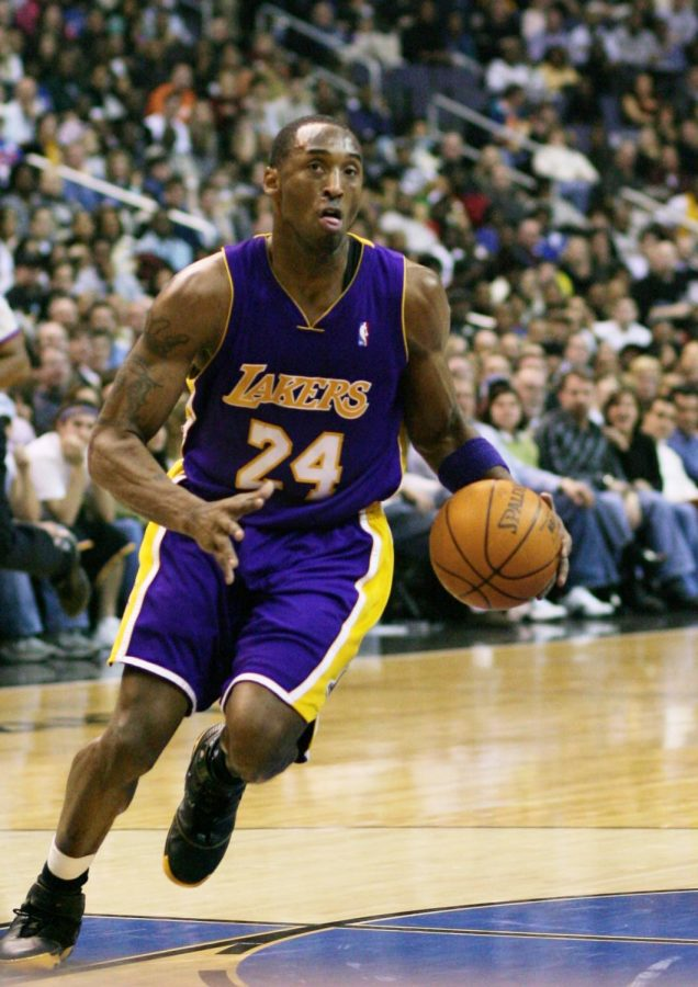 Kobe+Bryant+drives+the+ball+up+the+court+in+his+number+24+Lakers+jersey.+Bryant+played+for+the+Lakers+for+all+of+his+20+pro+seasons.+Photo+courtesy+of+Wikimedia+Commons.+