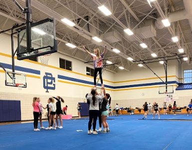Red Barons competitive cheer team makes their debut on the mat