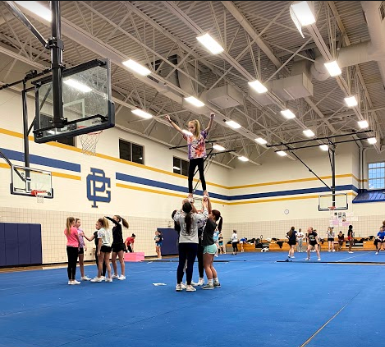 stunting: The girls practice round three with their stunt groups
