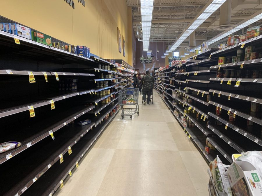 The+aisle+with+items+like+pasta+and+bread+is+being+severely+affected+on+March+13%2C+2020+at+Kroger.+All+photos+taken+by+Paige+Evers+%2722.