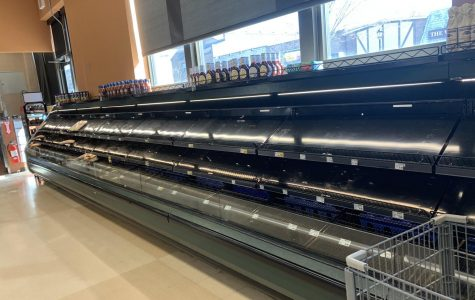 The prepared meat/meat section is nearly empty on March 13, 2020.