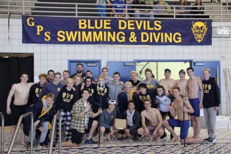 Boys swim and dive team celebrating their greats wins from the MAC meet.