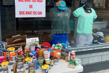 ALL IN THIS TOGETHER: The Campus Shop in The Village has collected food items for those in need. Grosse Pointers are welcomed to leave their excess food or pick up anything they've been looking for.