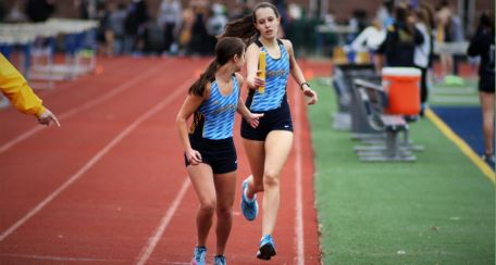 Missed opportunity: Victoria Gardey '20 passing the baton to Jenna Clark '20 during the 4X800 meter relay. Seniors who run track this year may not get the opportunity to do what they love because of the stay-at-home initiative.
