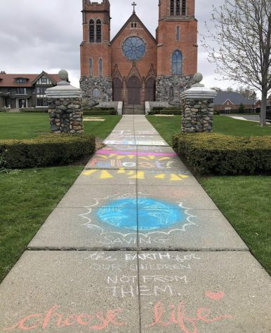St. Paul on the Lake Catholic Church pictured with the chalk art of Maddy Campbell