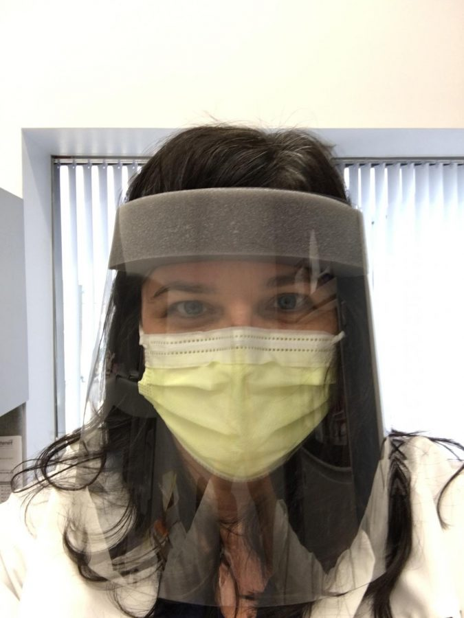 Keeping virus at bay: Ben Farber's '21 mother, shares her protective face mask and visor at work to keep her safe.