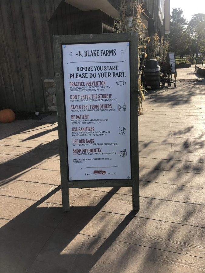Before entering the Blake's cider mill, everyone is greeted with a sign detailing Covid-19 restrictions. Photo courtesy of Keely Messacar '21.