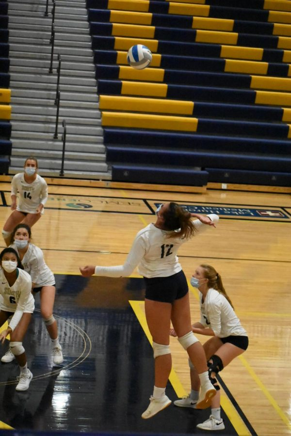 Jada Divita '22 spikes a ball during a game with South's varsity volleyball team. After graduating from South, Divita plans on attending Lipscomb University to play D1 volleyball.