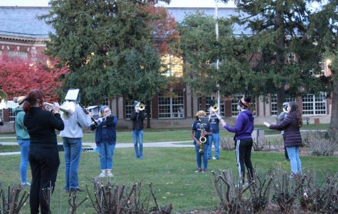 Grosse Pointe South's Band practicing outside socially distanced.