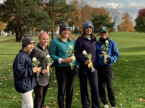 Left to right: Elli Ritchner '21, Jennifer Crowley '21, Audrey Becker '21, Alston Smith '21 and Giada Cavaliere '23 pose for a team photo with flowers that a mom on the team gave them. Photo credit: Kevin Nugent.