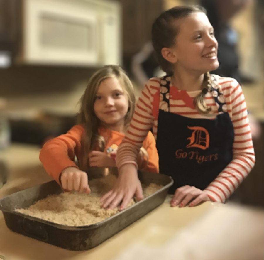 Phoebe King '23 and Violet King make baklava, a Lebanese dessert, on Thanksgiving in 2016. Unfortunately, they will not be able to complete this tradition this year because of changed plans due to COVID-19.