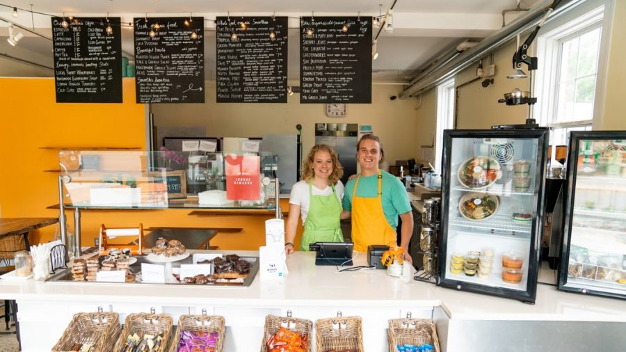 Owners Emma Kruse and Charles Kruse stand at the register serving smiles as always inside J House Juice.