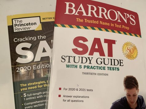 Two types of practice SAT books students use to study. Photo by Paige Evers