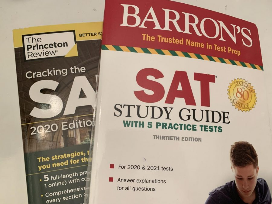 Two types of practice SAT books students use to study. Photo by Paige Evers '22