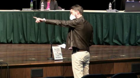 Teacher, Sean McCarrol points at the board of education..