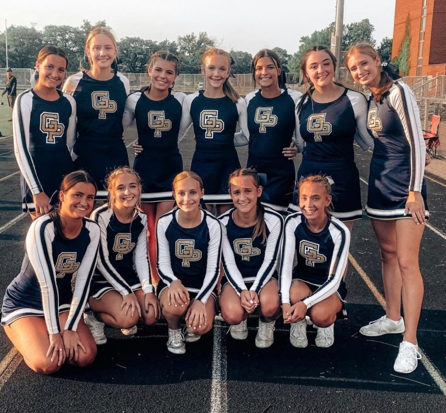 The cheer team poses for a photo prior to the first football game of the season against Detroit Renaissance. Photo courtesy of