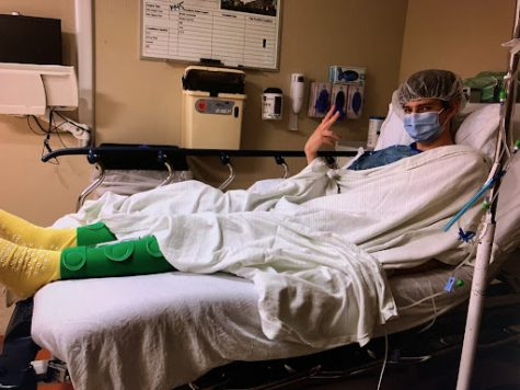 Nick Litsas 22 poses before surgery for his fractured collarbone.